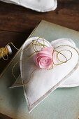 Silk flower on two hand-sewn fabric hearts