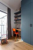 Retro chair at desk in niche in child's bedroom