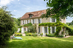 French country house with garden