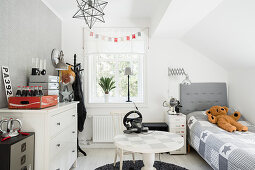 Boy's bedroom in shades of grey and white