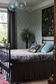 Metal bed with valance in glamorous bedroom
