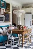 Silver and gold chairs at antique dining table in kitchen