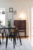 Table, chairs and tall retro sideboard in dining room