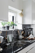 White kitchen with black tiled splashback