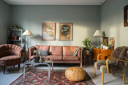 Vintage furniture in living room with blue-grey walls