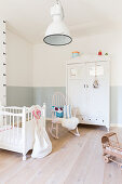 Two-tone wall and wooden floor in child's bedroom