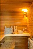 Basket, wooden bucket and other accessories in sauna