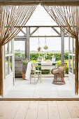 View through bead curtain onto veranda with panoramic view of countryside