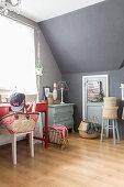 Creative attic room with grey wall and door in knee wall