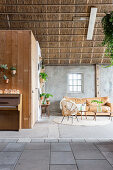 Many houseplants in living room in old, converted barn