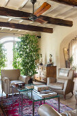 Two beige armchairs in Mediterranean living room