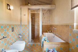 Bright blue accents in Mediterranean bathroom