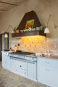 Classic mantel hood in Mediterranean kitchen