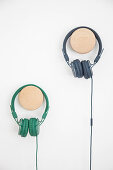 Headphones on wooden pegs on wall