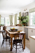 Rustic wooden table in the open kitchen with Mediterranean decoration