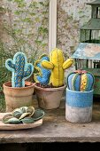 Various hand-sewn cacti and succulents with crocheted spines