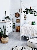 Boho bedroom in natural tones with house plants