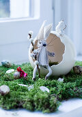 Hand-made cloth rabbit sitting in egg shell