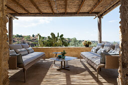Couches and coffee table on roofed terrace