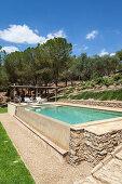Elegant swimming pool in Mediterranean garden