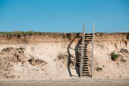 Wooden steps leading up sand dune