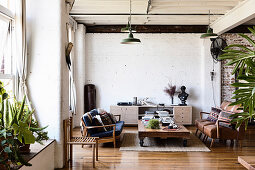 Living room with vintage furniture in the loft with white brick wall