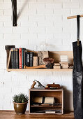 Shelves of tools and books on a brick wall