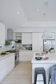 Large modern kitchen all in white with kitchen island