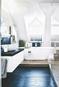 A free-standing bath tub in an elegant attic bathroom