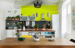 View over dining table into open-plan kitchen