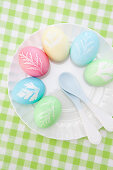 Pastel Easter eggs with leaf motifs