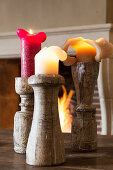 Partially used candles in wooden candlesticks