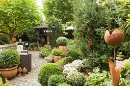 Path leading between flowerbeds and potted plants