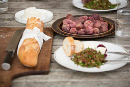 Baguette and beetroots on rustic table