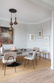 Upholstered chairs at oval table with stone top in dining room