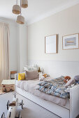 Bed with bedding box in classic, beige, child's bedroom