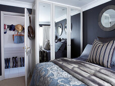 Double bed and wardrobe with mirrored doors in bedroom