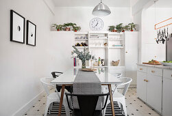 Dining table and chairs in white kitchen