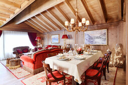 Set table in opulent interior with wood-beamed ceiling