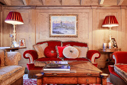 Opulent velvet sofas in red and grey in luxurious living room