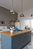 Modern country-house kitchen in blue, grey and white
