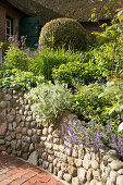 Raised herbaceous border with stone wall
