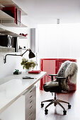Home office with white table top and drawer container