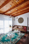 Brown leather couch and white tables in the living room with beamed ceilings