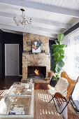 Classic leather chair with a fur blanket and houseplant in front of a fireplace in the living room
