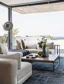 Luxurious living room with glass walls and sea view