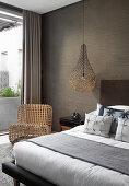 Sculptural furniture in bedroom in earthy tones