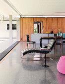 Terrazzo floor in open-plan interior of architect-designed house
