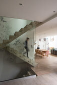 Concrete staircase with glass balustrade in modern apartment