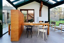 Dining table and chairs in modern conservatory